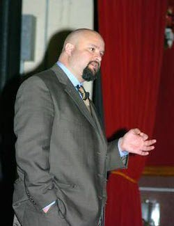 """Dr Ergun M. Caner addresses the """"War Eagles"""" during military instruction at the MCAS New River Theater on Apr 15. Caner conducted two periods of instruction regarding misconceptions and strategic protocols of a jihad. Photo by: Lance Cpl. Michael Angelo [Wikipedia]"""