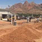 Polygamous FLDS cult erects wall around meetinghouse